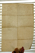 old letter held up against the light