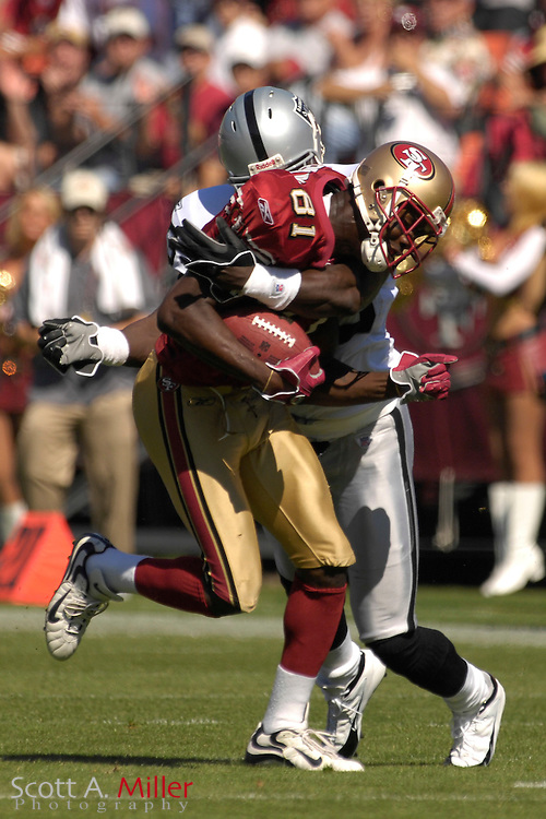 Oct. 8, 2006; San Francisco, CA, USA; San Francisco 49ers receiver (81) Antonio Bryant is tackled by Oakland Raiders defender (53) Thomas Howard during the first half at Monster Park. ....©2006 Scott A. Miller