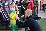 Teemu Pukki (22) of Norwich City signs the back of the shirt of a young Norwich fan ahead of the Premier League match between Bournemouth and Norwich City at the Vitality Stadium, Bournemouth, England on 19 October 2019.