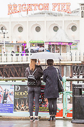 © Licensed to London News Pictures. 03/02/2018. Brighton, UK. Visitors to the Brighton's Palace Pier shelter from the rain in Brighton and Hove. Photo credit: Hugo Michiels/LNP