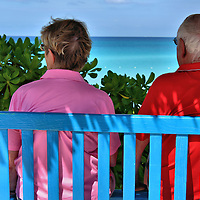 Couple Enjoying View from Bench at Half Moon Cay, Bahamas <br /> Half Moon Cay in The Bahamas has almost every amenity you&rsquo;d ever want for an active day on a tropical island.  But sometimes the best activity is sitting on a bench next to your spouse so you can enjoy the spectacular view of a sandy beach along the Atlantic Ocean.
