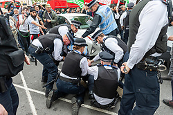 Police detain a man as demonstrators gathered outside India House in London to show support for Kashmiris and to protest against occupation and oppression by India in Kashmir. <br /> <br /> Richard Hancox   EEm 15082019