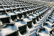 Snow covered seats in a baseball stadium.