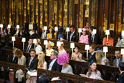 (Left to right, back row) George Clooney, Amal Clooney, Silver Tree, Abraham Levy, Celine Khavarani, Markus Anderson, Janina Gavankar, and Jill Smoller and unidentified guests take their seats in St George's Chapel at Windsor Castle for the wedding of Prince Harry to Meghan Markle.