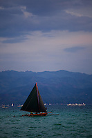 Sailing boat in the bay at White Beach, Boracay, Philippines.