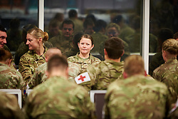 © Licensed to London News Pictures.  21/10/2014. CARTERTON, UK. Over 100 medics from 35 Squadron, 5 Medical Regiment depart from RAF Brize Norton for Freetown in Sierra Leone as part of the UK's response to the Ebola outbreak. The unit will man the Ebola Training Academy, training the local health care workers who staff the five treatment centres currently being built by the UK. <br /> <br /> In this picture: Medics waiting in the departure lounge.<br /> <br /> Photo credit: Cliff Hide/LNP