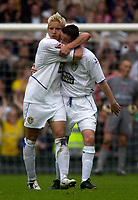 Photo. Glyn Thomas.<br /> Digitalsport<br /> NORWAY ONLY<br /> <br /> Leeds United v Charlton Athletic. <br /> FA Barclaycard Premiership. 08/05/2004.<br /> Leeds' Alan Smith (L) celebrates scoring in his final home game for the side from a penalty with Gary Kelly, as beaten keeper Dean Kiely (R) looks on.