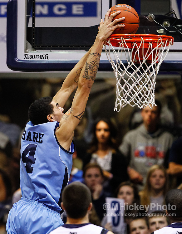 INDIANAPOLIS, IN - FEBRUARY 02: Jordan Hare #4 of the Rhode Island Rams goes up for a dunk against the Butler Bulldogs at Hinkle Fieldhouse on February 2, 2013 in Indianapolis, Indiana. Butler defeated Rhode Island 75-68. (Photo by Michael Hickey/Getty Images) *** Local Caption *** Jordan Hare