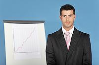 Businessman standing by flip chart portrait