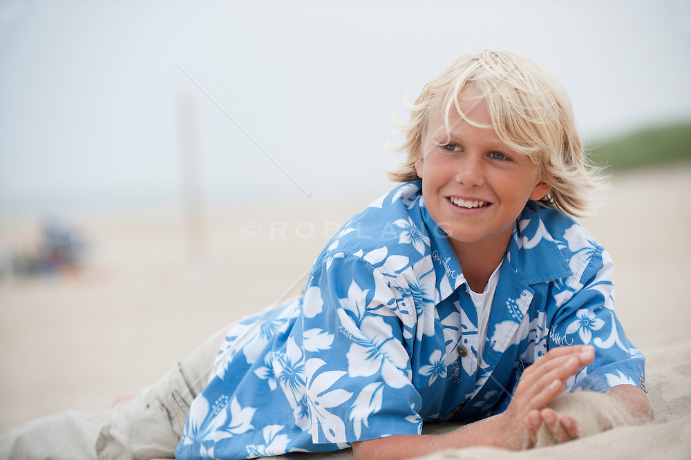 All American boy with blond hair on the beach in East Hampton, NY