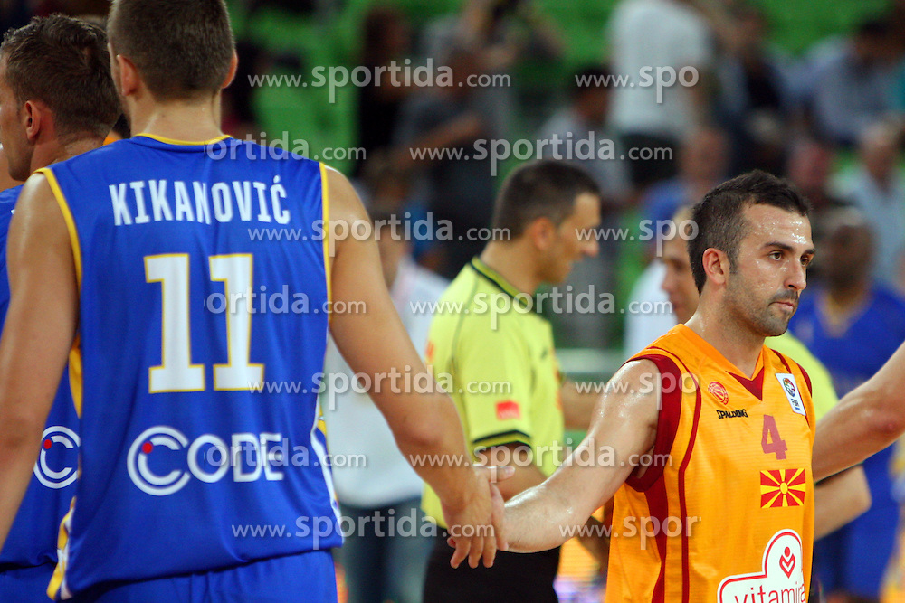 Dimitar Mirakovski of Macedonia and Elmedin Kikanovic of BiH at friendly match between Macedonia and BIH for Adecco Cup 2011 as part of exhibition games before European Championship Lithuania on August 6, 2011, in SRC Stozice, Ljubljana, Slovenia. (Photo by Urban Urbanc / Sportida)