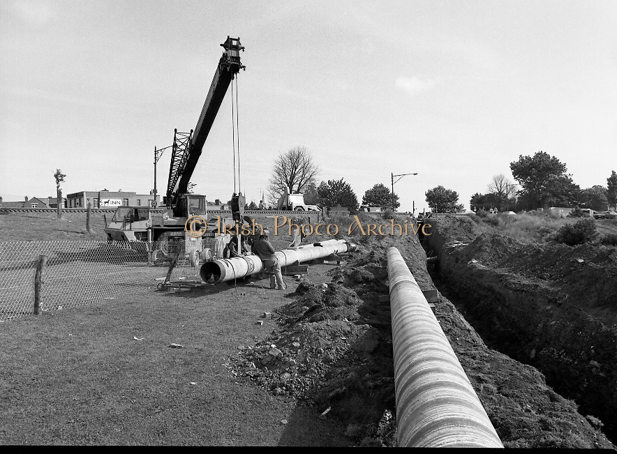 Kinsale Gas Pipeline to Dublin.1982.16.08.1982.08.16.1982.16th August 1982.The Kinsale to Dublin Gas Pipeline was scheduled to be commissioned in Jan '83..Picture of one of the final sections of pipe being installed.The picture was taken at Inchicore,Dublin on the banks of The Grand Canal.