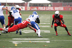 31 October 2015:   Davontae Harris(10) leans the way of Roland Genesy(24) to assist lunging Alex Donnelly(40) during the NCAA FCS Football between Indiana State Sycamores and Illinois State Redbirds at Hancock Stadium in Normal IL (Photo by Alan Look)
