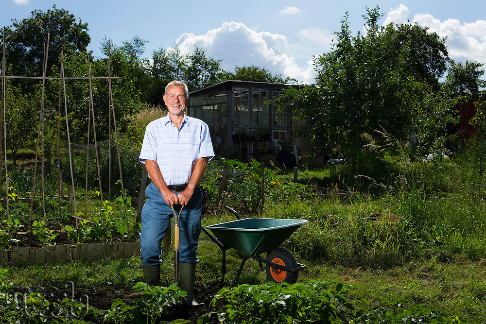 Senior man gardening portrait