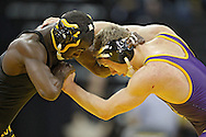 December 8, 2011: Iowa Hawkeyes Montell Marion and Northern Iowa Panthers Seth Noble in the 141 pound bout of the NCAA wrestling dual between the Northern Iowa Panthers and the Iowa Hawkeyes at Carver-Hawkeye Arena in Iowa CIty, Iowa on Thursday, December 8, 2011. Marion defeated Noble 18-8 and Iowa defeated Northern Iowa 38-4.