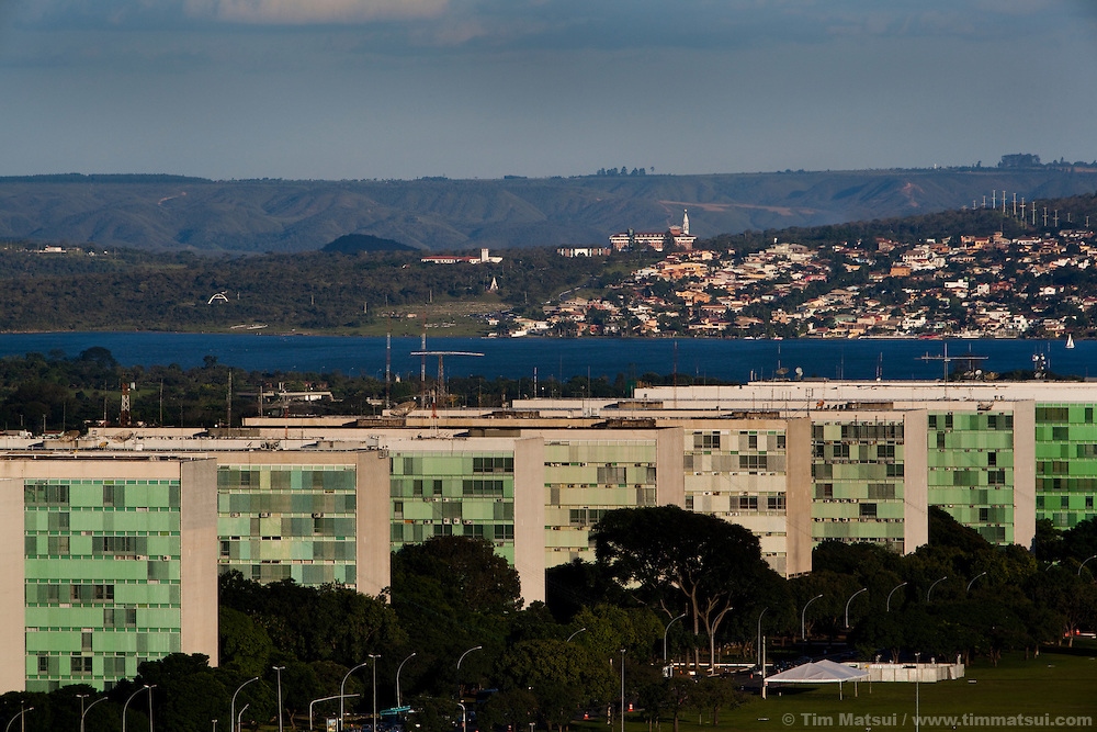Government ministry buildings line up near the Congress in Brasilia, the Capital of Brazil, and Lake Paranoá.