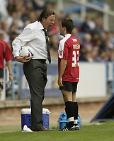Photo: Aidan Ellis.<br /> Huddersfield Town v Bristol City. Coca Cola League 1. 12/08/2006.<br /> Huddersfield manager Peter Jackson squares up to Bristol's Lee Johnson before being sent to the stands