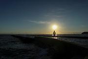Self-portrait taken at sunset at Utsumi beach resort.
