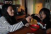 Kearny, New Jersey. November 19, 2013. Yadira Aleman feeds her son Yolo spoonfuls of soup in her kitchen in Kearny. Photo by Maya Rajamani/NYCity Photo Wire