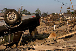 30 Sept, 2005.  New Orleans, Louisiana. Lower 9th ward. Hurricane Katrina aftermath. <br /> The remnants of the lives of ordinary folks, now covered in mud as the flood waters remain.  Cars lay flipped over and scattered about the landscape.<br /> Photo; ©Charlie Varley/varleypix.com