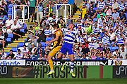 Reading defender Paul McShane (5) battles with Preston North End forward Jordan Hugill (25) during the EFL Sky Bet Championship match between Reading and Preston North End at the Madejski Stadium, Reading, England on 6 August 2016. Photo by Jon Bromley.
