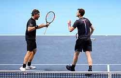 Bruno Soares (left) and Jamie Murray (right) celebrate during their doubles match during day seven of the Nitto ATP Finals at The O2 Arena, London.
