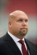 Arizona Cardinals general manager Steve Keim looks on from the sideline during pre game warmups before the 2014 NFL preseason football game against the Houston Texans on Saturday, Aug. 9, 2014 in Glendale, Ariz. The Cardinals won the game in a 32-0 shutout. ©Paul Anthony Spinelli