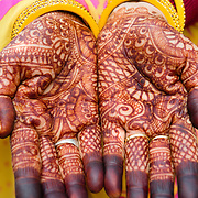 Detail of Indian woman's hands covered in henna tattoos
