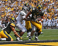 September 07 2013: Iowa Hawkeyes running back Mark Weisman (45) pulls players into the end zone on a touchdown run during the third quarter of the NCAA football game between the Missouri State Bears and the Iowa Hawkeyes at Kinnick Stadium in Iowa City, Iowa on September 7, 2013. Iowa defeated Missouri State 28-14.