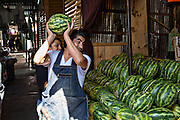 Watermelon vendor at Benito Juarez market in Oaxaca, Mexico.