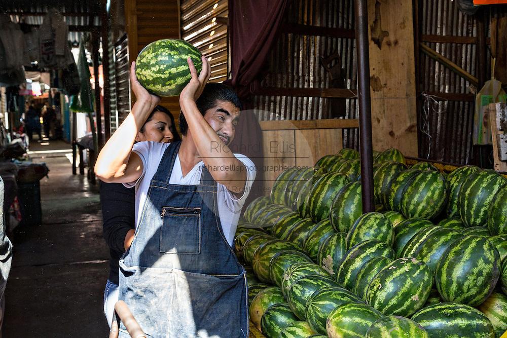 Watermelon vendor at Benito Juarez market in Oaxaca, Mexico.