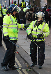 © under license to London News Pictures. 9/12/2010. A policeman is covered in paint. On the day that MPs vote on tuition fees, 1000s demonstrated in London against a proposed rise in fees and cuts in support. Credit should read Matt Cetti-Roberts/London News Pictures