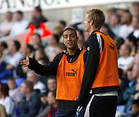 Photo: Chris Ratcliffe.<br /> Tottenham Hotspur v Portsmouth. The Barclays Premiership. 01/10/2006.<br /> Mido of Spurs explains to Calum Davenport his views on Sol Campbell.