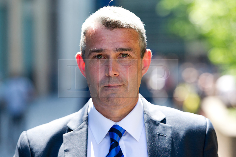 © London News Pictures. 05/06/2013. London, UK. MARK HANNA, former head of security at News International, leaving Southwark Crown Court in London where he faced charges relating to phone hacking scandal at News International and payments to officials. Photo credit: Ben Cawthra/LNP