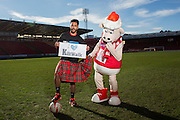 Wednesday11th February, 2015, Aberdeen, Scotland. Dons defender Shay Logan and AFC Community Trust mascot, Donny the Sheep, will officially launch the Aberdeen Kiltwalk 2015 as they call on Aberdeen fans to sign up to The Kiltwalk to raise funds for the club&rsquo;s partner charity, Aberdeen FC Community Trust.<br />  <br /> Pictured:  Shay Logan and Donny the Sheep<br /> <br /> (Photo: Ross Johnston/Newsline Media)