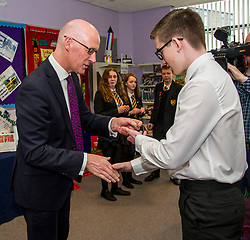 Pictured: John Swinney was called upon to habnd out the student helper badges<br /> Education Secretary  John Swinney visited Grangemouth High School library today to launch the second round of bidding for a national funding programme aimed at improving school library services. <br /> <br /> <br /> Ger Harley | EEm 16 April 2018