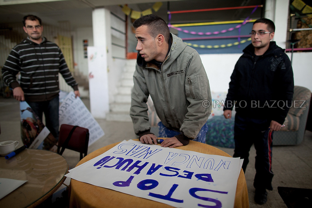 Vicente's grandson, Jonathan Torres 24 makes anti-eviction banners to spread near his house in Madrid, on April 14 2012. Spanish Vicente Torres, 73, who is severely ill and underwent a recent heart surgery, and is waiting for a thrombus surgery faces an eviction from his house next April 18th after he endorsed his son, so Citibank would concede a credit to buy a house. His son already handed his house to the bank. Torres has lived at his home for the last 55 years and was paying it for 30 years. Eviction procedures in Spanish courts for unpaid mortgages and rent hit a record of 58,241 in 2011, a 21.2 percent rise over the previous year. Evictions have soared in Spain since the collapse of a property bubble in 2008 that triggered the country's economic crisis.