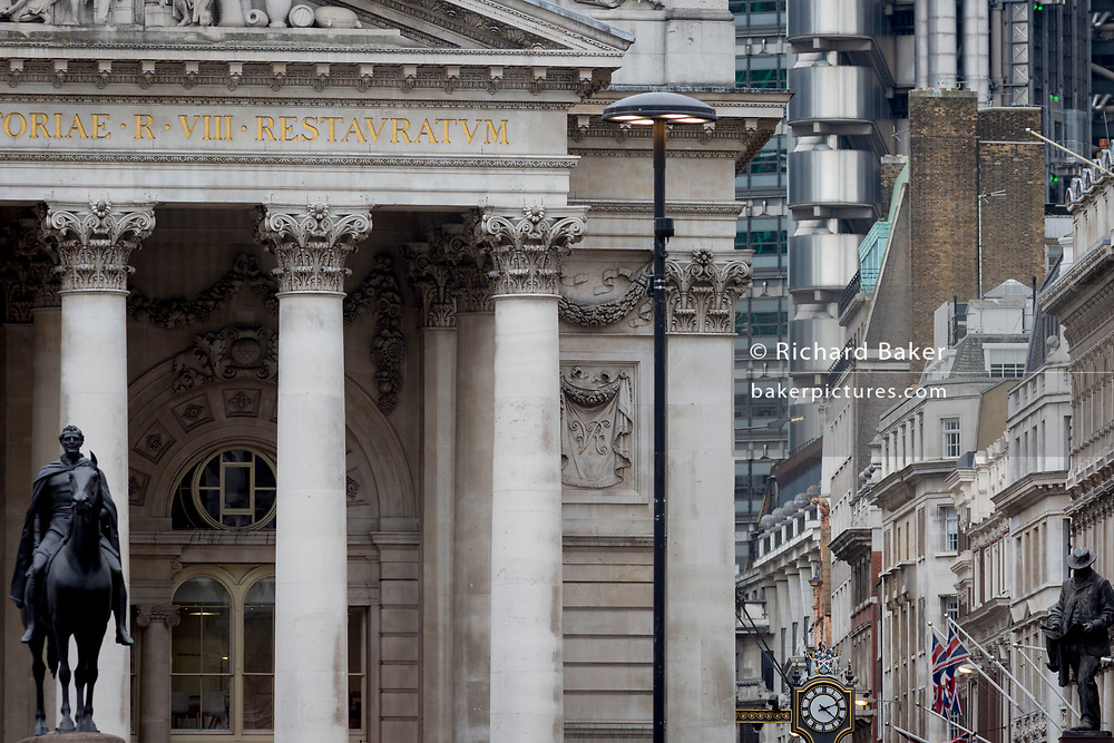 The Equestrian statue of the Duke of Wellington (L) and civil engineer James Henry Greathead (R) with architecture from many decades at Cornhill in the City of London, the capital's financial district (aka The Square Mile), on 26th March, 2018, in London, England.