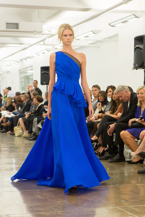 Electric blue one-shoulder gown with asymmetrical top. By Carmen Marc Valvo at the Spring 2013 Fashion Week show in New York.