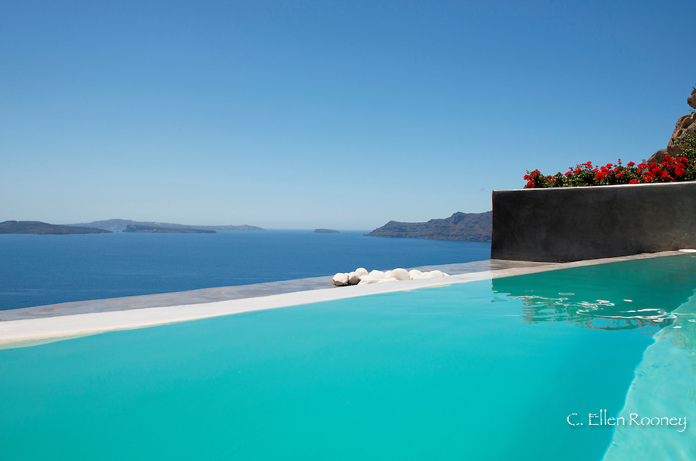A swimming pooling overlooking the caldera in Oia, Santorini, The Cyclades, The Aegean, The Greek Islands, Greece, Europe