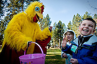"JEROME A. POLLOS/Press..Asher Chivvis, right and Carlee Jackson, both 6, hang out with Sarah Plummer, the ""Easter Chicken"" during an Easter scavenger hunt Friday coordinated by students at North Idaho College. Students from the college's Resort and Recreation Management program led kindergartners from Sorensen Magnet School on the hunt to help the children learn team building and problem solving."