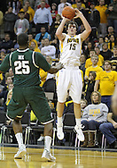 February 2 2011: Iowa Hawkeyes forward Zach McCabe (15) puts up a shot over Michigan State Spartans center Derrick Nix (25) during the first half of an NCAA college basketball game at Carver-Hawkeye Arena in Iowa City, Iowa on February 2, 2011. Iowa defeated Michigan State 72-52.