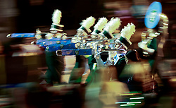 13 Feb 2015. New Orleans, Louisiana.<br /> Mardi Gras. Green Wave, Tulane Marching Band makes its way along Magazine Street with Krewe D'Etat.<br /> Photo; Charlie Varley/varleypix.com