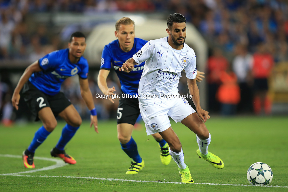 14 September 2016 - UEFA Champions League (Group G) - Club Brugge v Leicester City - Riyad Mahrez of Leicester City in action with Benoit Poulan and Ricardo van Rhijn of Club Brugge  Photo: Marc Atkins / Offside.