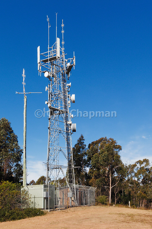 Antennas, lattice tower and base station equipment shelter 3 sector cellular  communications  mobile telephone system in New South Wales, Australia.