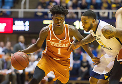 Feb 20, 2017; Morgantown, WV, USA; Texas Longhorns guard Andrew Jones (1) dribbles while defended by West Virginia Mountaineers guard Tarik Phillip (12) during the first half at WVU Coliseum. Mandatory Credit: Ben Queen-USA TODAY Sports