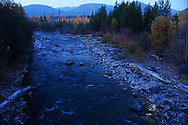 Bowman Creek at dawn by moonlight in fall. Glacier National Park, northwest Montana.