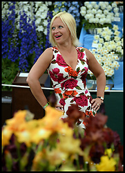 Anna Townsend looks at the flower display on the VIP preview day at the Chelsea Flower Show. London, United Kingdom. Monday, 19th May 2014. Picture by Andrew Parsons / i-Images