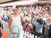 31/07/2014 Repro free The winner of the Anthony Ryans Best Dressed Lady Competition on Ladies Day at the Galway Races is Helen Murphy from Douglas, Co.Cork.  A secondary school teacher wore a  mint green midi skirt and white top from Coast.  It was accessorised with an Aisling Maher multi coloured pearl necklace and a white disc hat embellished with broaches from Dunnes Stores.  She also wore a 1950's vintage Walborg clutch and shoes from Nine West.