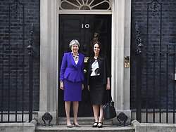 Prime Minister Theresa May (left) stands with the Prime Minister of New Zealand Jacinda Ardern on the doorstep of 10 Downing Street, London, ahead of bilateral talks during the Commonwealth Heads of Government Meeting.